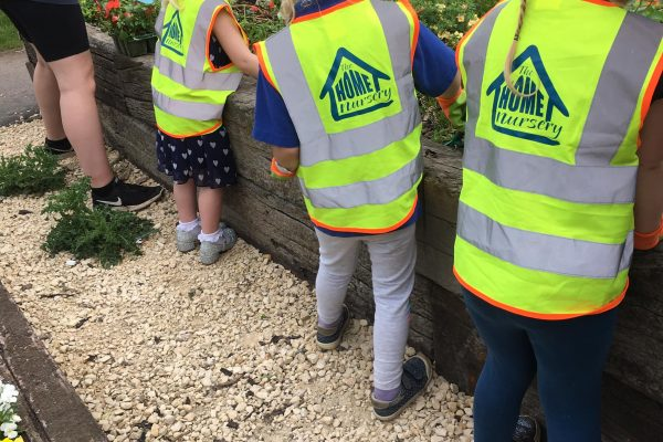Children from Home Nursery have been out and about helping with planting of Busy Lizzies.
